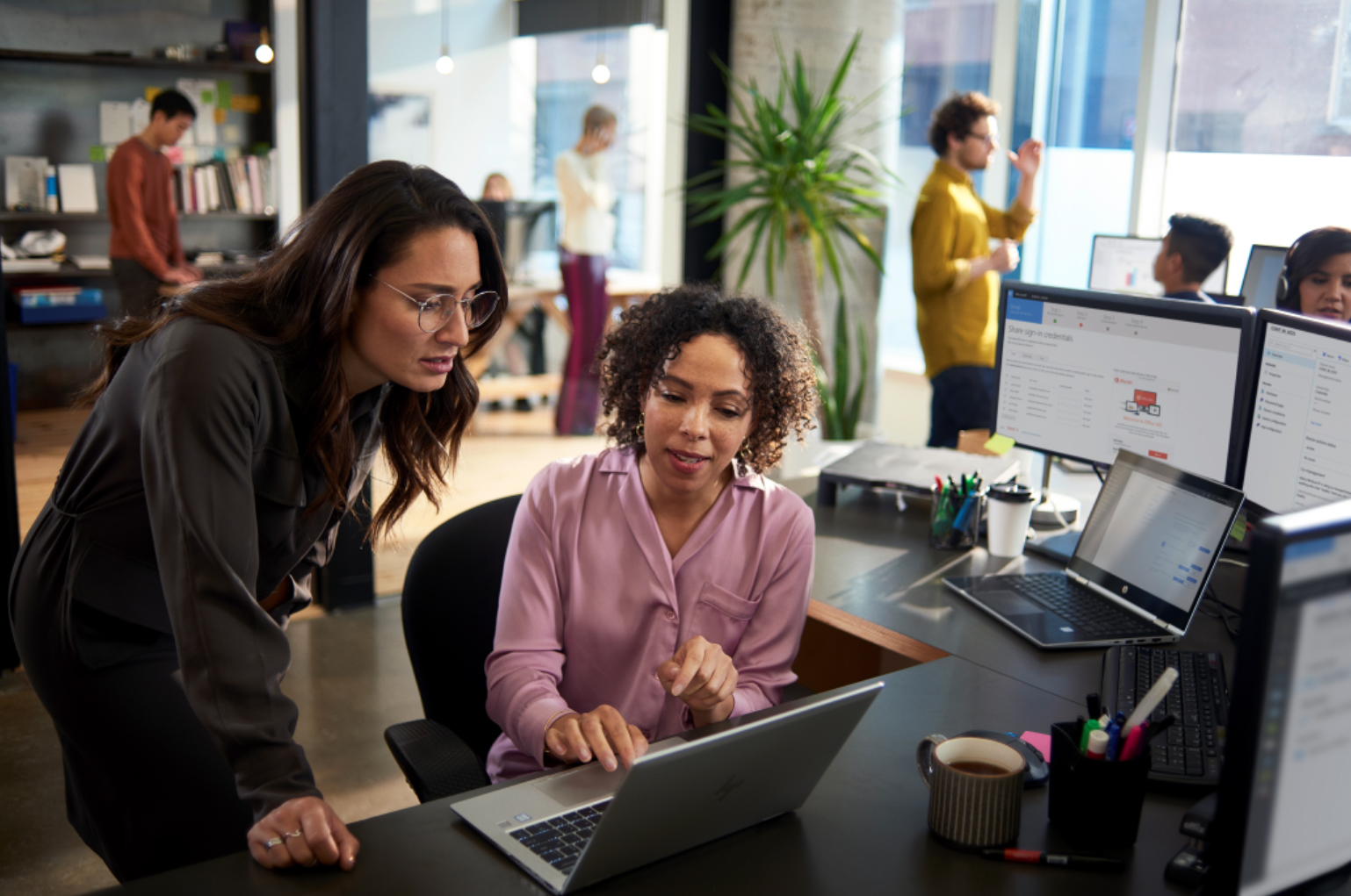 Microsoft increasing transparency and customer control over data Two-women-in-office-with-laptop.jpg